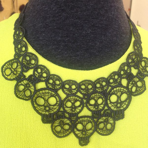 round-skull-necklace-on-yellow-dress