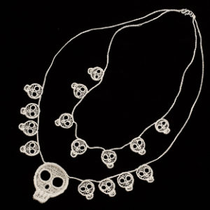 Lace skulls double necklace