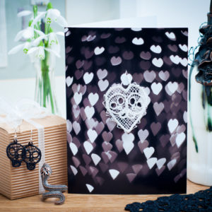 Black and white hearts lace skulls card