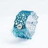 Fringe lace cuff bracelet in peacock